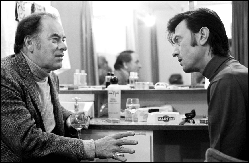 Actor John Ireland (1914 - 1992) visiting Laurence Harvey (1928 - 1973) backstage West End, London - 1971
